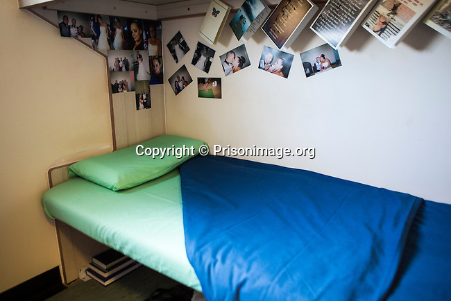 A prisoners bottom bunk bed, with family pictures up on the wall. HMP/YOI Portland, Dorset. A resettlement prison with a capacity for 530 prisoners. <br /> &copy; prisonimage.org.  Any image use must be agreed first. All images must be properly credited.