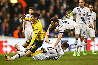 Julian Weigl of Borussia Dortmund (left), Kevin Wimmer of Tottenham Hotspur (27) and Ryan Mason of Tottenham Hotspur battle for the ball during the UEFA Europa League match between Tottenham Hotspur and Borussia Dortmund at White Hart Lane, London, England on 17 March 2016. Photo by David Horn / PRiME Media Images