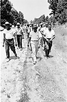 Martin Luther King Jr at the head of the line of marchers along route of 2nd Meredith March Against Fear through Mississippi photographed by Jim Peppler for essay published in The Southern Courier on June 25, 1966. Copyright Jim Peppler/1966.  This and over 10,000 other images are part of the Jim Peppler Collection at The Alabama Department of Archives and History:  http://digital.archives.alabama.gov/cdm4/peppler.php