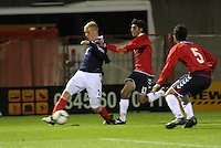 Jack Grimmer chased by Artur Petrosyan in the Scotland v Armenia UEFA European Under-19 Championship Qualifying Round match at New Douglas Park, Hamilton on 9.10.12.