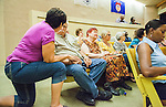 Volunteers for local cat rescue organizations listen to the public speakers pleading with the City Council to reconsider the ban on feeding feral cats on public property in Antioch, California, on August 26, 2014.  Photo/Victoria Sheridan