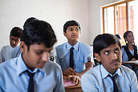 Adarsh Patidar, aged 15, studies in class in Vasudha Vidya Vihar school in Khargone, Madhya Pradesh, India on 12 November 2014. Adarsh, the son of a Fairtrade Cotton Producer, wants to follow in his father's footsteps and become a cotton farmer. The school was built using the Fairtrade Premium of the Fairtrade Cotton Producers. Photo by Suzanne Lee for Fairtrade