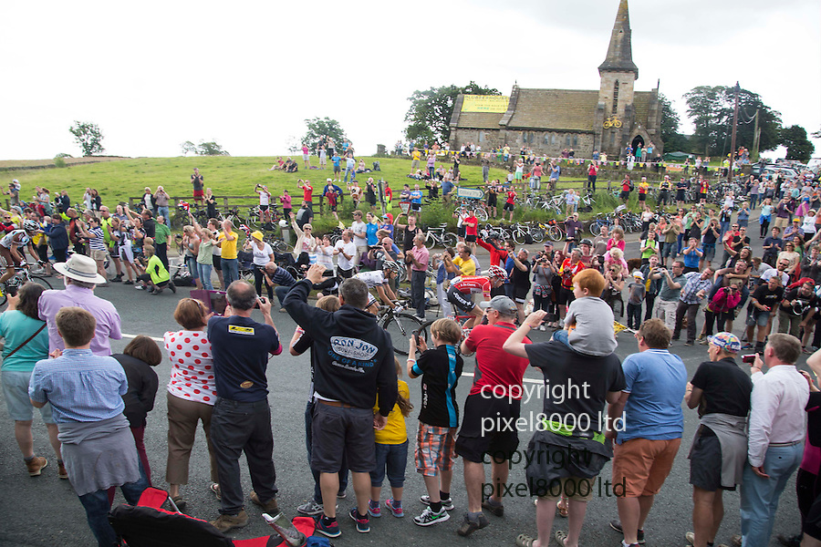 "Grand Depart - Tour de France 2014<br /> Yorkshire England.<br /> Second stage passes through ""Blubberhouses Moor""<br /> on the road from Harrogate<br /> Huge crowds wave through the leaders and peloton<br /> <br /> <br /> Pic by Gavin Rodgers/Pixel 8000 Ltd"