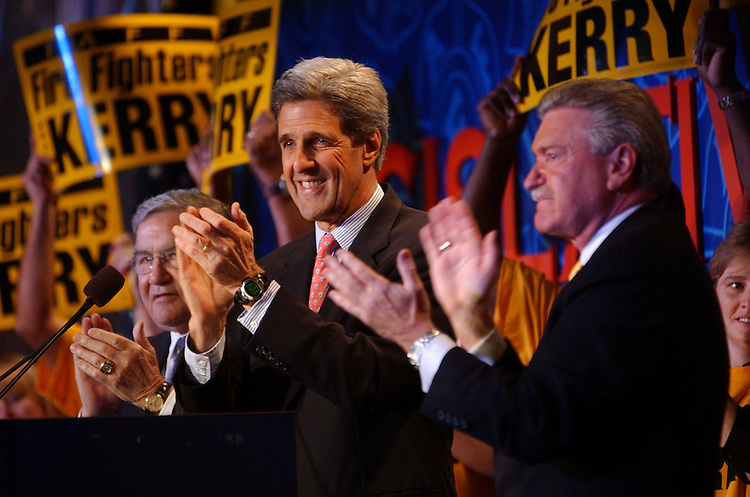 Sen. John Kerry, D-Mass., gestures to the crowd at the International Association of Fire Fighters Legislative Conference, Monday.   Harold Schaitberger, president of IAFF, appears at right, and Vincent Bollon, secretary-treasurer,  appears at left.