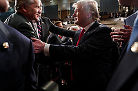 FEBRUARY 5, 2019 - WASHINGTON, DC: President Trump shook hands with lawmakers after the State of the Union at the Capitol in Washington, DC on February 5, 2019. <br /> Credit: Doug Mills / Pool, via CNP
