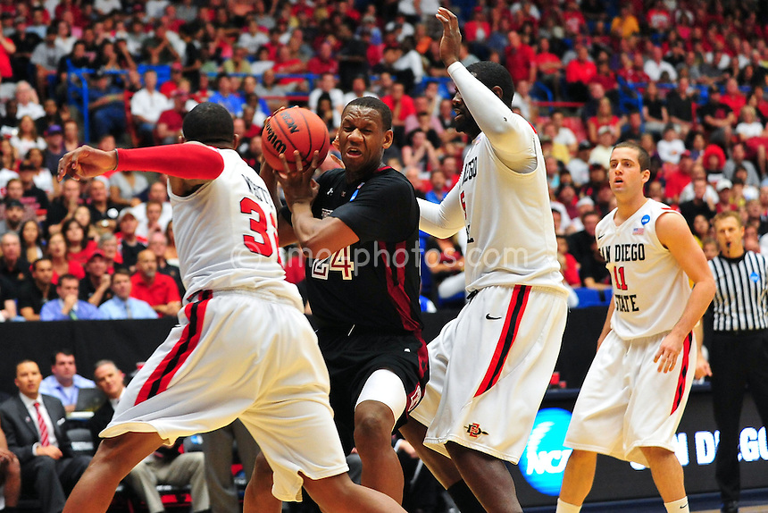 Mar 19, 2011; Tucson, AZ, USA; Temple Owls forward Lavoy Allen (24) tries to split a double team in the first half of a game against the San Diego State Aztecs in the third round of the 2011 NCAA men's basketball tournament at the McKale Center.
