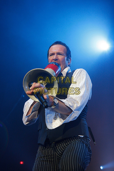 STONE TEMPLE PILOTS - SCOTT WEILAND .Performing live at the Brixton Academy, London, England..June 16th, 2010.stage concert live gig performance music half length black shirt white shirt waistcoat singing profile microphone .CAP/MAR.© Martin Harris/Capital Pictures.