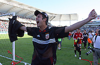 D.C. United's Mike Petke celebrates after defeating the Kansas City Wizards 3-2 at the MLS Cup, at the Home Depot Center, in Carson, Calif., Sunday, Oct. 14, 2004.