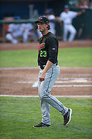 Great Falls Voyagers pitching coach John Ely (23) walks off the field after a visit to the mound during a Pioneer League against the Ogden Raptors at Lindquist Field on August 23, 2018 in Ogden, Utah. The Ogden Raptors defeated the Great Falls Voyagers by a score of 8-7. (Zachary Lucy/Four Seam Images)