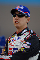 Apr 20, 2006; Phoenix, AZ, USA; Nascar Nextel Cup racer Kyle Busch driver of the (5) Kelloggs/Carquest Chevrolet Monte Carlo prior to qualifying on the pole for the Nextel Cup Subway Fresh 500 at Phoenix International Raceway. Mandatory Credit: Mark J. Rebilas