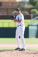 Glendale Desert Dogs relief pitcher Zach Thompson (49), of the Chicago White Sox organization, gets ready to deliver a pitch during an Arizona Fall League game against the Scottsdale Scorpions at Camelback Ranch on October 16, 2018 in Glendale, Arizona. Scottsdale defeated Glendale 6-1. (Zachary Lucy/Four Seam Images)