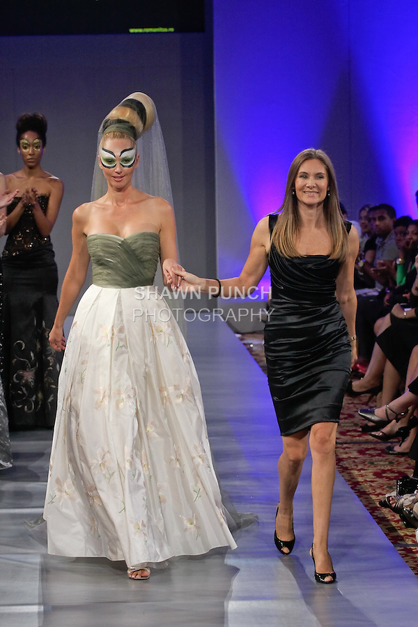 Fashion designer Romanita Claudia Iovan, walks the runway at the close of her Romanitza fashion show, celebrating her 20th anniversary in fashion; during Couture Fashion Week, September 16, 2011.
