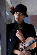 Rhiannon Giddens of the Carolina Chocolate Drops poses with her violin.