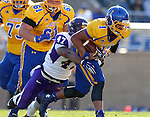 BROOKINGS, SD - OCTOBER 24:  Taryn Christion #1 from South Dakota State is brought down by Ronelle McNeil #47 from University of Northern Iowa in the second quarter of their game Saturday afternoon at Coughlin Alumni Stadium in Brookings. (Photo by Dave Eggen/Inertia)