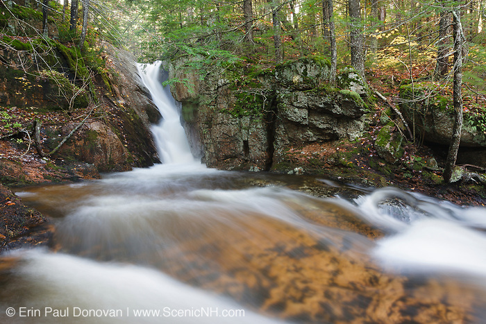 Ellen's Falls, located on Hobbs Brook, in Albany, New Hampshire USA during the autumn months.