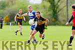 John Daly Currow goes past John Fitzgearld Castleisland Desmonds during their Intermediate Championship clash in Castleisland on Sunday