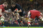 All Blacks captain Richie McCaw charges at Wales pair Samson Lee and Dan Lydiate<br /> Dove men Series 2014<br /> Wales v New Zealand<br /> 22.11.14<br /> &copy;Steve Pope -SPORTINGWALES