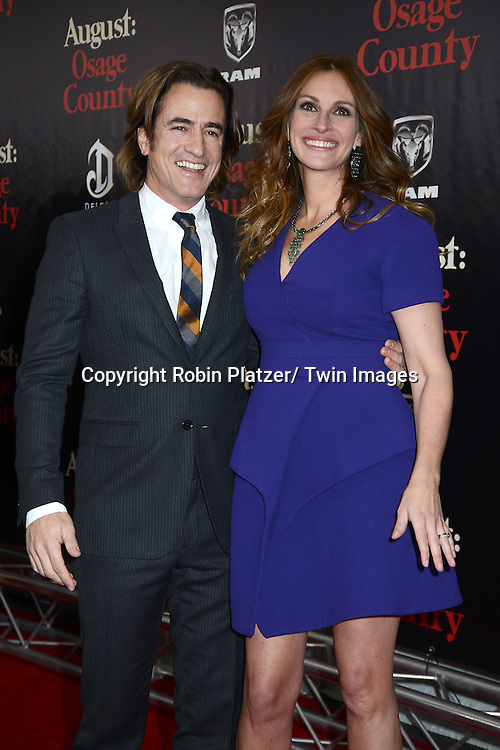 """Dermot Mulroney and Julia Roberts attends the New York Premiere of """"August: Osage County"""" on December 12, 2013 at the Ziegfeld Theatre in New York City."""