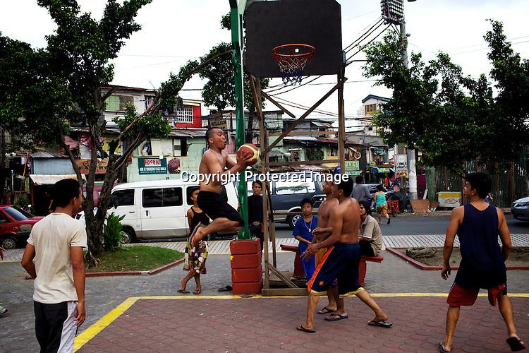 Filipino youth play basketball at the Remedios circle in Malate, Manila in Philippines. Photo: Sanjit Das