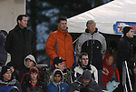 11 December 2009: Kris Kelderman (center) and Bob Gansler (right) watch the game. The University of Virginia Cavaliers defeated the Wake Forest University Demon Deacons 2-1 after overtime at WakeMed Soccer Stadium in Cary, North Carolina in an NCAA Division I Men's College Cup Semifinal game.