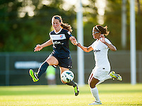 Sky Blue FC defender Madeleine Thompson (25) plays the ball under pressure from Washington Spirit forward Lindsay Taylor (17) during a National Women's Soccer League (NWSL) match at Yurcak Field in Piscataway, NJ, on July 6, 2013.