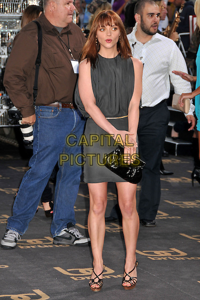 """CHRISTINA RICCI .""""Bruno"""" Los Angeles Premiere held at Grauman's Chinese Theatre, Hollywood, CA, USA..June 25th, 2009 .full length grey gray sleeveless dress black clutch bag mouth open .CAP/ADM/BP.©Byron Purvis/AdMedia/Capital Pictures."""
