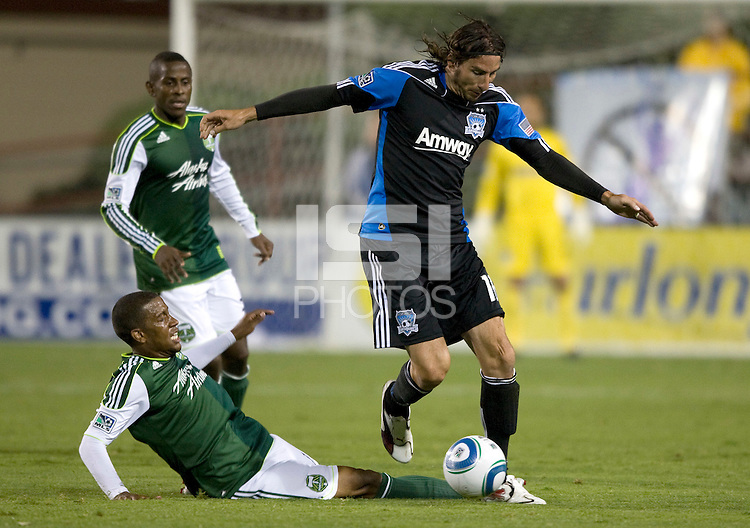 Alan Gordon of Earthquakes controls the ball away from Timbers defender during the game at Buck Shaw Stadium in Santa Clara, California on August 6th, 2011.   San Jose Earthquakes and Portland Timbers tied 1-1.