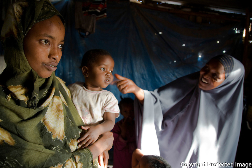 "Koos Aw Dahir - 40, right, and Siida Noor Ahmed, left..Has been living in State House since 1992 .11 children - oldest, 22, youngest, 3.Koos looks after four of Siida's children..Siida fled mogadishu after she lost her husband and 3 children in the onging war...""I have 11 children and my own problems, but I was touched by the problems of Siida.  I fled Somaliland during the 1988 war in Somalia so I know the problems of a refugee.  I cannot forget the war.  There was fighting, bullets.  Our men were being slaughtered in front of us like goats.  When we fled, we were afraid of wild animals.  Hyenas are around during war - they like the taste of human flesh.""  ..""When people first arrive, they are very afraid. They still have the feeling of where they've come from.  When I look at them, it's like looking at people running out of a burning house.  The new families who come here have nothing so they rely on us.""  .. ""When it was built, State House was very beautiful.  I never went in and saw it, the closest you could get was the gate.  But people who'd seen inside used to tell stories, it was marvelous.  .There are so many problems here now though.  There is no water, no medical centre, no playgrounds for the children."".  .""I want the international community to look with a kind eye on the community living in State House.  Already we are displaced in our own country with no water, education, health services.  At the same time, we have another group of refugees adding to our problems.""."
