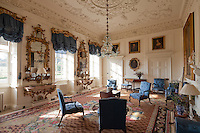 The blue drawing room is appointed with an Axminster carpet (1755), William Mathie gilt-wood mirrors (1759), George Mercer console tables, and a Thomas Chippendale suite of elbow chairs and settees (1759), newly upholstered in silk damask from a pattern found in the house