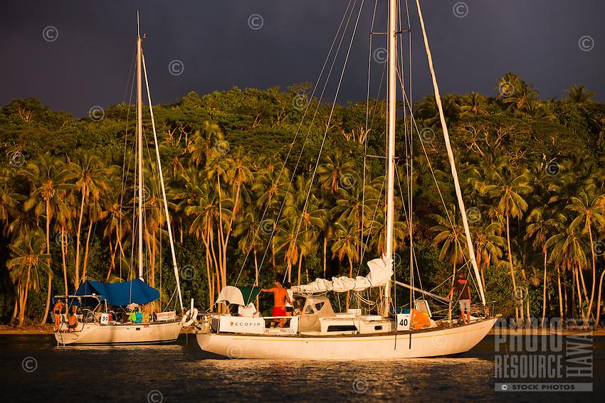 Yachts anchored off Bora Bora at sunset