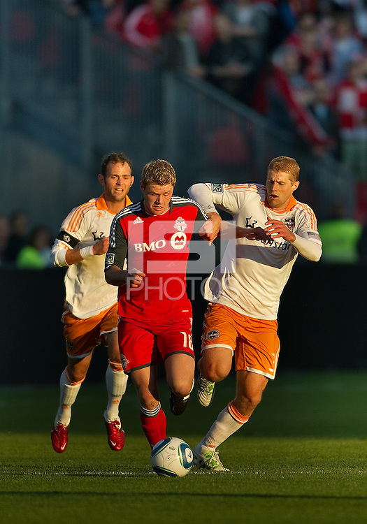 07 May2011: Houston Dynamo defender Andre Hainault #31and Toronto FC forward Nick Soolsma #18 in action during an MLS game between the Houston Dynamo and the Toronto FC at BMO Field in Toronto, Ontario.