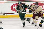 Nick Luukko (UVM - 25), Michael Sit (BC - 18) - The Boston College Eagles defeated the visiting University of Vermont Catamounts to sweep their quarterfinal matchup on Saturday, March 16, 2013, at Kelley Rink in Conte Forum in Chestnut Hill, Massachusetts.