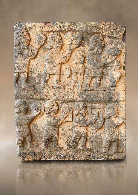 Pictures & images of the South Gate Hittite sculpture stele depicting Hittite Gods. 8th century BC. Karatepe Aslantas Open-Air Museum (Karatepe-Aslantaş Açık Hava Müzesi), Osmaniye Province, Turkey.  Against art background
