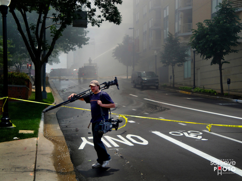 A TV news photographer working a downtown Madison, Wisconsin fire.