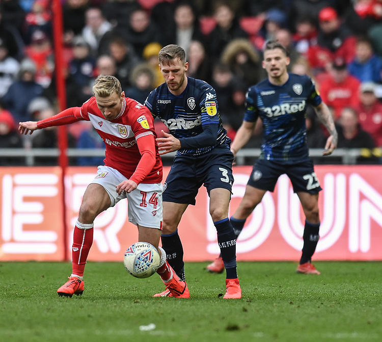 Bristol City's Andreas Weimann (left) under pressure from Leeds United's Barry Douglas (right) <br /> <br /> Photographer David Horton/CameraSport<br /> <br /> The EFL Sky Bet Championship - Bristol City v Leeds United - Saturday 9th March 2019 - Ashton Gate Stadium - Bristol<br /> <br /> World Copyright © 2019 CameraSport. All rights reserved. 43 Linden Ave. Countesthorpe. Leicester. England. LE8 5PG - Tel: +44 (0) 116 277 4147 - admin@camerasport.com - www.camerasport.com