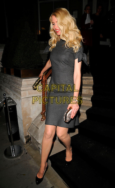CLAUDIA SCHIFFER .The Dom Perignon Vintage Champagne party, The Landau restaurant, London, England..February 26th, 2008.full length grey gray dress black shoes white clutch bag purse .CAP/CAN.©Can Nguyen/Capital Pictures.