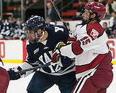 Cody Learned (Yale - 12), Seb Lloyd (Harvard - 15) - The visiting Yale University Bulldogs defeated the Harvard University Crimson 2-1 (EN) on Saturday, November 15, 2014, at Bright-Landry Hockey Center in Cambridge, Massachusetts.