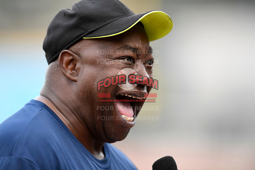 Former South Carolina football star and Heisman Trophy winner George Rogers laughs during a TV interview before the Celebrities vs. Soldiers Softball Game as part of the South Atlantic League All-Star Game festivities on Monday, June 19, 2017, at Spirit Communications Park in Columbia, South Carolina. (Tom Priddy/Four Seam Images)