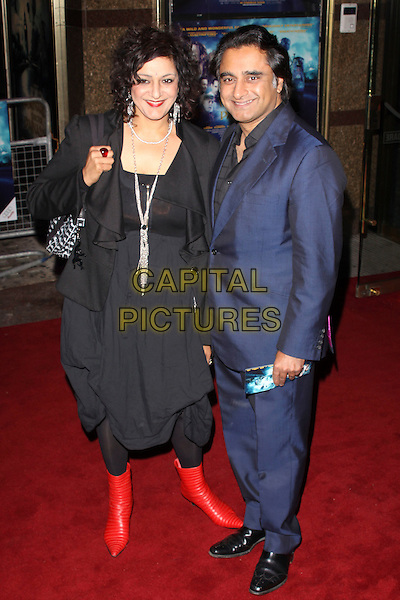 "MEERA SYAL & SANJEEV BHASKAR.The UK Premiere of ""The Imaginarium Of Doctor Parnassus"" at the Empire Leicester Square, London, England.  .October 6th, 2009 .full length black dress blue suit red boots gathered ankle skirt jacket married husband wife .CAP/AH.©Adam Houghton/Capital Pictures."