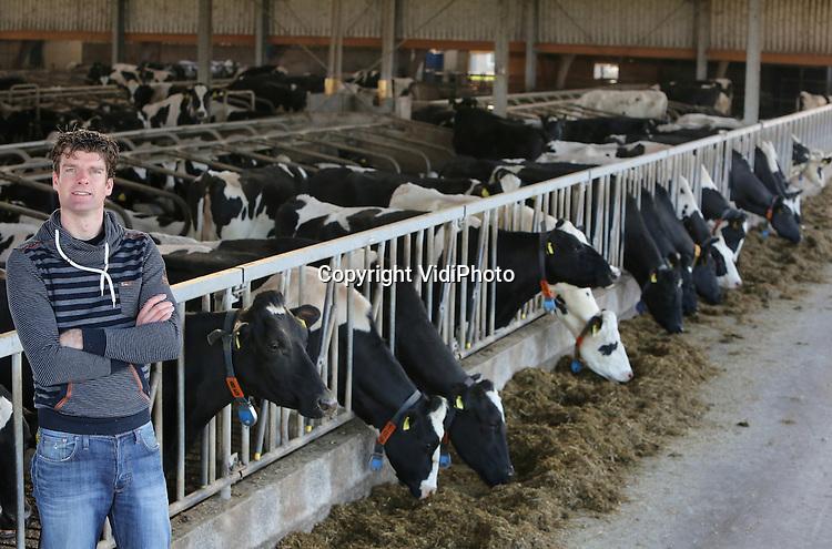 Foto: VidiPhoto<br /> WERKHOVEN &ndash; Melkveehouder Koen Dorresteijn uit Werkhoven in zijn nieuwe melkveestal. Dorresteijn heeft 160 melkoeien.