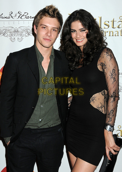 XAVIER SAMUEL & SHERMINE SHAHRIVAR. 4th Annual Sports Dream Celebrity Poker and Pool Party Celebrating the 2010 ESPY Awards held at the Playboy Mansion, Beverly Hills, California, USA..July 12th, 2010.half length jacket suit shirt black green  black lace dress clutch bag.CAP/ADM/BP.©Byron Purvis/AdMedia/Capital Pictures.