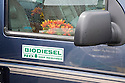 A bumper sticker on the door of a van converted to run on biodiesel. The sticker reads 'Biodiesel, No War Required'. San Francisco, California, USA