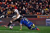9th January 2018, Mestalla Stadium, Valencia, Spain; Copa del Rey football, round of 16, second leg, Valencia versus Las Palmas; Martin Montoya, right defender for Valencia CF dribbles past goalkeeper Lizoain for Las Palmas during the game