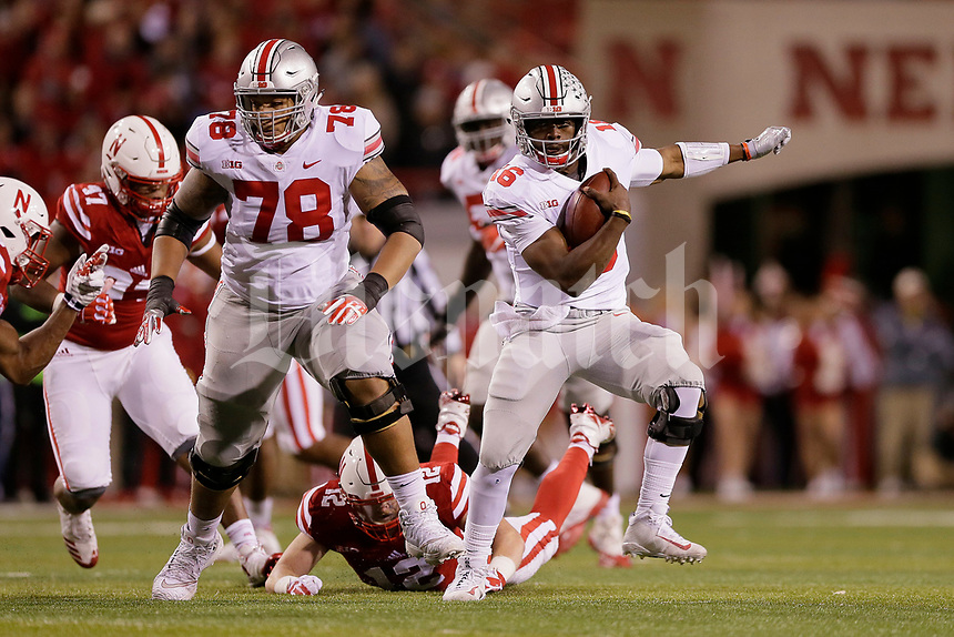 Ohio State Buckeyes quarterback J.T. Barrett (16) rushes upfield ahead of offensive lineman Demetrius Knox (78) during the second quarter of the NCAA football game against the Nebraska Cornhuskers at Memorial Stadium in Lincoln, Neb. on Oct. 14, 2017. [Adam Cairns/Dispatch]