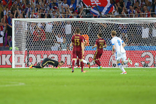 15.06.2016. Lille, France. UEFA Euro 2016 Group B soccer match Russia and Slovakia at Stade Pierre Mauroy in Lille Metropole, France, 15 June 2016.  Weiss (Slo) scores the first goal past goalie Igor Akinfeev (Rus )