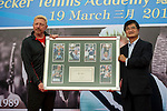 Tennis legend Boris Becker (left) gives a gift to  Ke Guangming  during the press conference for the opening of Boris Becker Tennis Academy at Mission Hills Resort on 19 March 2016, in Shenzhen, China. Photo by Lucas Schifres / Power Sport Images