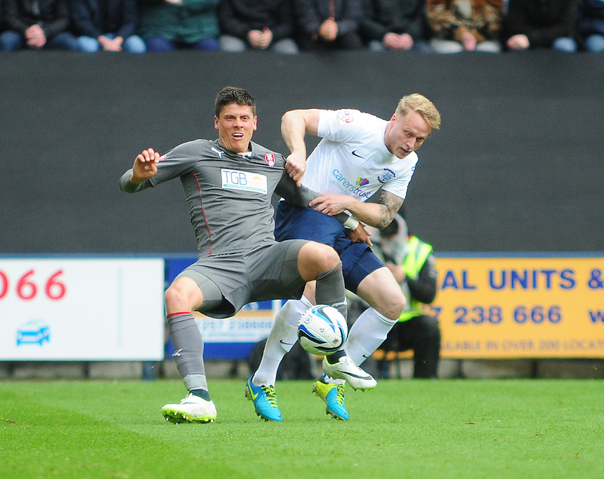 Rotherham United's Alex Revell is tackled by Preston North End's Tom Clarke <br /> <br /> Photographer Chris Vaughan/CameraSport<br /> <br /> Football - The Football League Sky Bet League One Play-Off First Leg - Preston North End v Rotherham United - Saturday 10th May 2014 - Deepdale - Preston<br /> <br /> &copy; CameraSport - 43 Linden Ave. Countesthorpe. Leicester. England. LE8 5PG - Tel: +44 (0) 116 277 4147 - admin@camerasport.com - www.camerasport.com