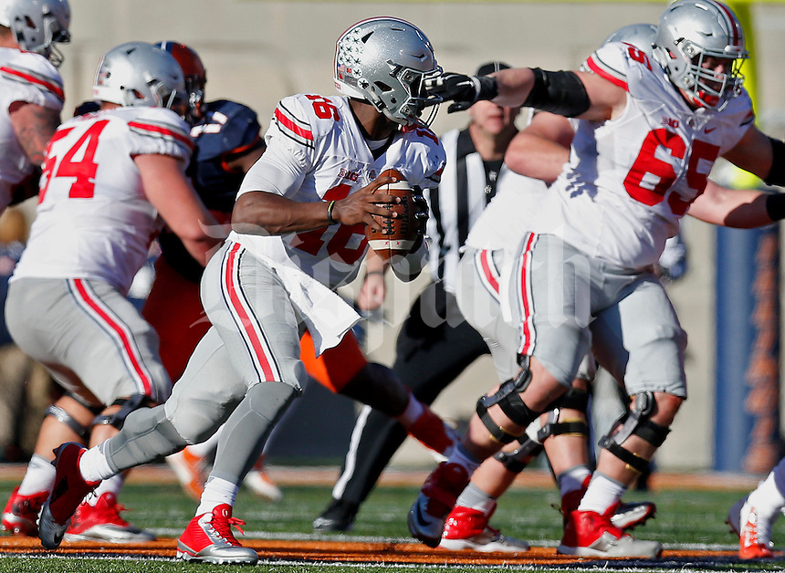 Ohio State Buckeyes quarterback J.T. Barrett (16) attempts to gain yards in the second half of their game at Memorial Stadium in Champaign, Ill on November 14, 2015. (Columbus Dispatch photo by Brooke LaValley)