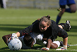04 November 2009: Duke's Tara Campbell (in black) climbs over Florida State's Tiffany McCarty (below) to grab the ball. The Florida State University Seminoles defeated the Duke University Blue Devils 2-0 at Koka Booth Stadium in WakeMed Soccer Park in Cary, North Carolina in an Atlantic Coast Conference Women's Soccer Tournament Quarterfinal game.