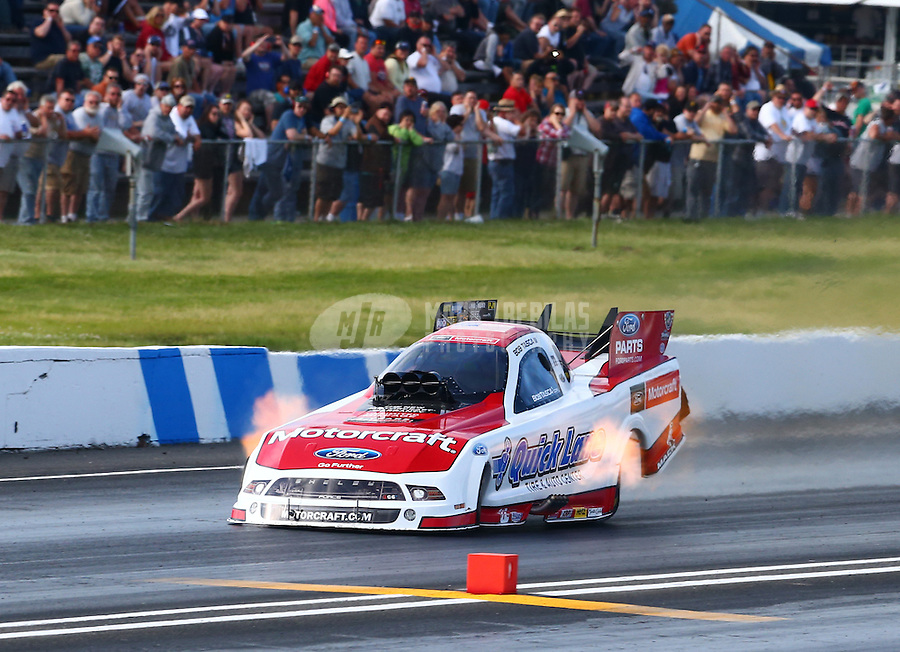 May 31, 2014; Englishtown, NJ, USA; NHRA funny car driver Bob Tasca III during qualifying for the Summernationals at Raceway Park. Mandatory Credit: Mark J. Rebilas-